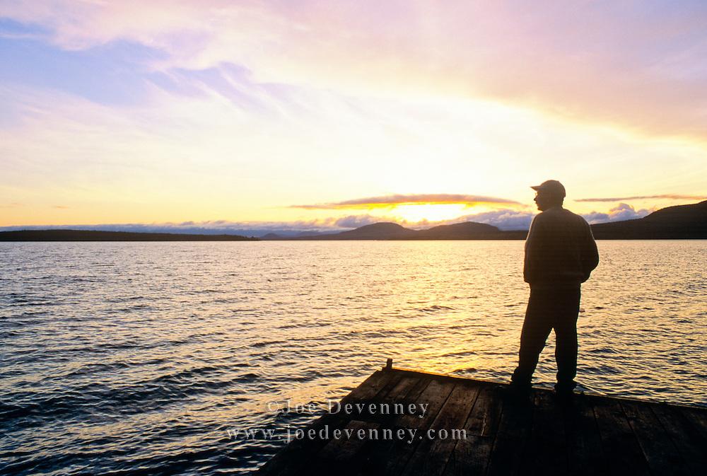 Man on a dock at sunrise. Moosehead Lake. Rockwood, Maine
