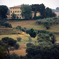 A large estate sits on top of a hill in the countryside of Tuscany, Italy