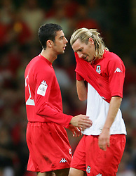 CARDIFF, WALES - Wednesday, September 8, 2004: Wales' Robbie Savage walks off the pitch in tears after being sent off against Northern Ireland during the Group Six World Cup Qualifier at the Millennium Stadium. (Pic by David Rawcliffe/Propaganda)