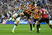 Millwall defender Shaun Hutchinson (4) shot blocked by Bradford City midfielder Romain Vincelot (6)  during the EFL Sky Bet League 1 play off final match between Bradford City and Millwall at Wembley Stadium, London, England on 20 May 2017. Photo by Martin Cole.