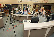 Houston ISD multimedia staff prepare for a remote broadcast of a Broad Foundation research team tour and press conference at Ortiz Middle School, May 29, 2013.