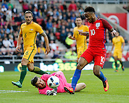Raheem Sterling (10) of England is beaten to the bal by Mathew Ryan of Australia during the International Friendly match at the Stadium Of Light, Sunderland<br /> Picture by Simon Moore/Focus Images Ltd 07807 671782<br /> 27/05/2016