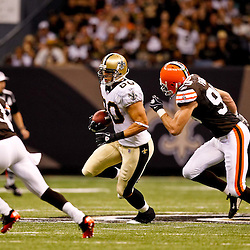 Oct 24, 2010; New Orleans, LA, USA; New Orleans Saints tight end Jimmy Graham (80) runs as Cleveland Browns linebacker Scott Fujita (99) and defensive back Mike Adams (20) pursue the play during the first half at the Louisiana Superdome. Mandatory Credit: Derick E. Hingle
