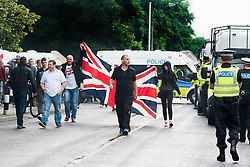 After hiolding thier rally EDL members and Supporters are escorted out of Hexthorpe back into Doncaster Town Centre on Saturday. The EDL and UAF are thought to have chosen Hexthorpe after recent media reports of tension between newly arrived Roma residents and the the local community<br /> 19 July 2014<br /> Image © Paul David Drabble <br /> www.pauldaviddrabble.co.uk