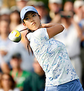 Michelle Wie of the US hits a tee shot on the 1st hole during the first round of the US Women's Open Golf Championship at Newport Country Club in Newport Rhode Island, Friday 30 June 2006
