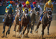 Arkansas Democrat-Gazette/MELISSA SUE GERRITS - 04/12/2014 -  Horses and jockeys, with winner Luis Saez, second from left, run into the first turn during the the Handicap race at Oaklawn park April 12, 2014.