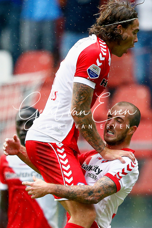 Onderwerp/Subject: FC Utrecht - Eredivisie<br /> Reklame:  <br /> Club/Team/Country: <br /> Seizoen/Season: 2013/2014<br /> FOTO/PHOTO: Steve DE RIDDER (DOWN) of FC Utrecht celebrating his second goal and Dave BULTHUIS ( Davy BULTHUIS ) (UP) of FC Utrecht ( 2 - 0 ). (Photo by PICS UNITED)<br /> <br /> Trefwoorden/Keywords: <br /> #02 $94 &plusmn;1371811811150<br /> Photo- &amp; Copyrights &copy; PICS UNITED <br /> P.O. Box 7164 - 5605 BE  EINDHOVEN (THE NETHERLANDS) <br /> Phone +31 (0)40 296 28 00 <br /> Fax +31 (0) 40 248 47 43 <br /> http://www.pics-united.com <br /> e-mail : sales@pics-united.com (If you would like to raise any issues regarding any aspects of products / service of PICS UNITED) or <br /> e-mail : sales@pics-united.com   <br /> <br /> ATTENTIE: <br /> Publicatie ook bij aanbieding door derden is slechts toegestaan na verkregen toestemming van Pics United. <br /> VOLLEDIGE NAAMSVERMELDING IS VERPLICHT! (&copy; PICS UNITED/Naam Fotograaf, zie veld 4 van de bestandsinfo 'credits') <br /> ATTENTION:  <br /> &copy; Pics United. Reproduction/publication of this photo by any parties is only permitted after authorisation is sought and obtained from  PICS UNITED- THE NETHERLANDS