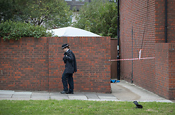 © Licensed to London News Pictures. 08/10/2016. London, UK. A police tent covers part of a garden Police near the scene of a shooting in Eastney Road, Croydon. Police were called to reports of a man suffering a gunshot wound at 11.30 PM on Friday night. Officers from the Homicide and Major Crime Command are investigating after the man was pronounced dead at the scene.Photo credit: Peter Macdiarmid/LNP