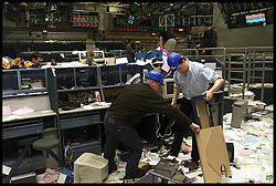 .TTP11/AP/28/4/LIFFE CLOSES /DIG .PIC BY ANDREW PARSONS LIFFE, LONDON. THE DISMANTLE OF THE BEAR PIT AS IT CLOSED TODAY ..STAFF FROM LIFFE RON WITHERS AND PETER CLANCY ( BLUE SHIRT)Workman remove computers from the stockmarket floor as City traders and Bankers from Liffe surrounded by papers carrying on working as the bear pit is dismantled as Liffe closes in the City of London, April 2000. Photo By Andrew Parsons/i-Images