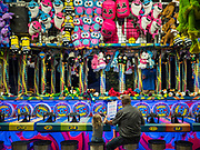 14 AUGUST 2019 - DES MOINES, IOWA: People play a game on the children's midway at the Iowa State Fair. The Iowa State Fair is one of the largest state fairs in the U.S. More than one million people usually visit the fair during its ten day run. The 2019 fair run from August 8 to 18.               PHOTO BY JACK KURTZ