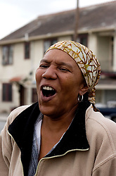 16 Jan, 2006. New Orleans, Louisiana. Post Katrina.<br /> Charmaine Neville, singer and sister to the famous Neville Brothers joins the 'unofficial' Martin Luther King Jr parade. The C3/Hands off Iberville coalition march almost 6 miles from the devastated Lower Ninth Ward to downtown New Orleans in an alternative protest to the Mayor's officially sanctioned celebrations marking Martin Luther King Jr day. The protest remembered those who perished and claims to stand up for the rights of displaced, primarily african americans.<br /> Photo; Charlie Varley/varleypix.com