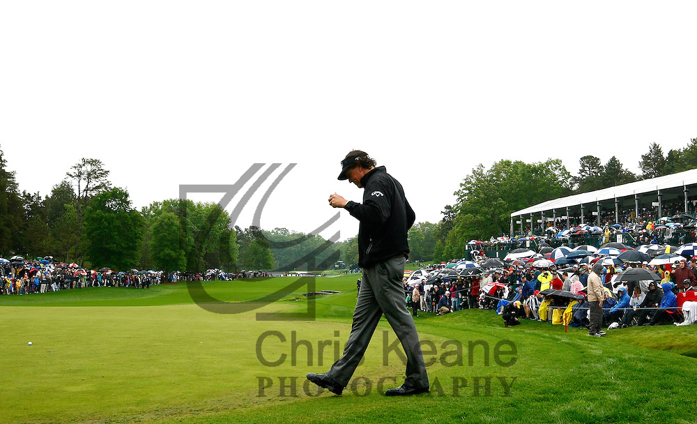 Phil Mickelson of the U.S. reacts to his missed putt on the 18th hole during the final round of the Wells Fargo Championship at the Quail Hollow Club in Charlotte, North Carolina on May 5, 2013.  (Photo by Chris Keane - www.chriskeane.com)
