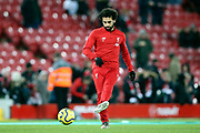 Liverpool forward Mohamed Salah (11) warming up during the Premier League match between Liverpool and Everton at Anfield, Liverpool, England on 4 December 2019.