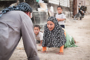 The beauty of the moment....an impromptu push-up contest on the streets of Siwa, Egypt with Australian adventurer Tom Smitheringale. <br /> <br /> Photographed on the One Man Epic expedition, 2011.