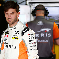 Daniel Suarez (19) hangs out in the garage during practice for the Gander Outdoors 400 at Dover International Speedway in Dover, Delaware.
