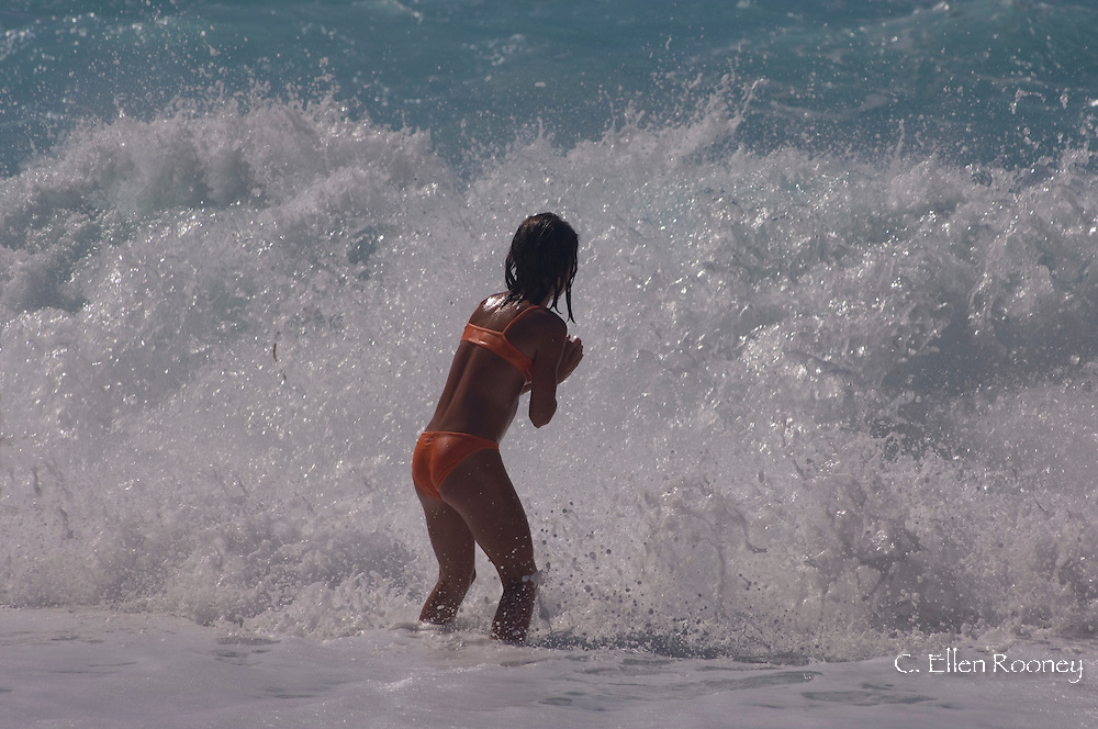 A young girl playing in surf at Myrtos Beach.  Kefalonia, the Ionian Islands, Greece