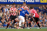 Photo: Paul Greenwood.<br />Everton v Sheffield United. The Barclays Premiership. 21/10/2006.  Everton's Andy Johnson battles with Chris Morgan, left, and Michael Tonge as Mikele Leigertwood (21) closes in.
