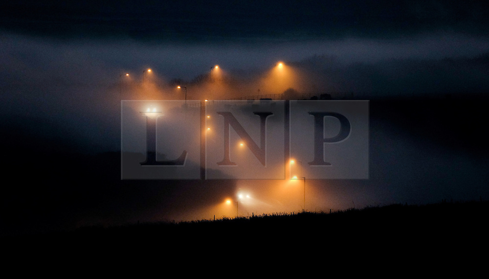 © Licensed to London News Pictures.02/11/15<br /> Saltburn, UK. <br /> <br /> Cars make their way down a hill shrouded in heavy fog near Saltburn in Cleveland.<br /> <br /> Photo credit : Ian Forsyth/LNP