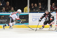 KELOWNA, CANADA, FEBRUARY 17: Shane McColgan #18 of the Kelowna Rockets checks Danny Gayle #22 of the Calgary Hitmen at the Kelowna Rockets on February 17, 2012 at Prospera Place in Kelowna, British Columbia, Canada (Photo by Marissa Baecker/Shoot the Breeze) *** Local Caption ***