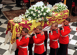 "Embargoed to 0001 Monday August 21 File photo dated 06/09/97 of coffin of Diana, Princess of Wales, is carried inside Westminster Abbey for her funeral service. Diana, Princess of Wales was a woman whose warmth, compassion and empathy for those she met earned her the description the ""people's princess""."