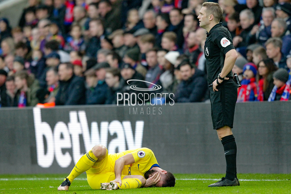 Chelsea striker Olivier Giroud (18) clutches his ankle during the Premier League match between Crystal Palace and Chelsea at Selhurst Park, London, England on 30 December 2018.