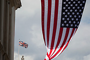 On US President Donald Trump's first day of a controversial three-day state visit to the UK by the 45th American President, the US Stars and Stripes flag hangs on Whitehall with the figure of Lord Nelson on the top of his column in Trafalgar Square, on 3rd June 2019, in London England.