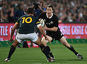 JOHANNESBURG, South Africa, 04 October 2014 : Ben Smith of the All Blacks steps outside Handré Pollard of the Springboks during the Castle Lager Rugby Championship test match between SOUTH AFRICA and NEW ZEALAND at ELLIS PARK in Johannesburg, South Africa on 04 October 2014. <br /> The Springboks won 27-25 but the All Blacks successfully defended the 2014 Championship trophy.<br /> <br /> © Anton de Villiers / SASPA