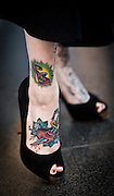 Tattooed feet and ankles of a woman who identified herself Angie Rabbit, at an Art Center South Florida gallery opening during Art Basel Miami Beach 2006