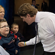 January 16, 2014:  Detroit Red Wings head coach Mike Babcock greets a disabled fan who is a guest of The Garden of Dreams during the game between The New York Rangers and The Detroit Red Wings at  Madison Square Garden in Manhattan, New York . The New York Rangers shut out The Detroit Red Wings 1-0. (Credit Image: © Kostas Lymperopoulos/Cal Sport Media)