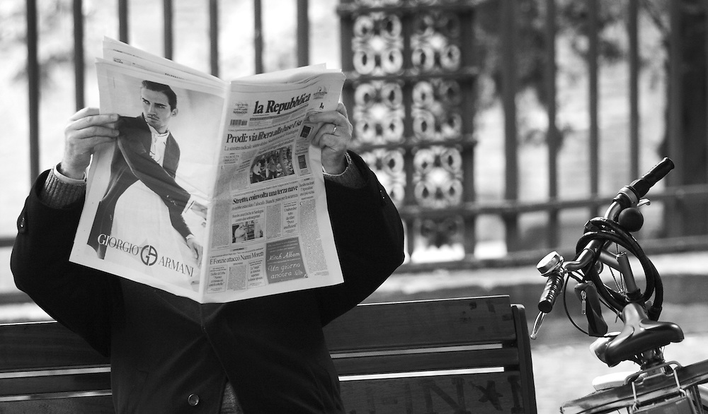 "Man reading newspaper in Bologna Italy by Karl R Lilliendahl photographer.This black and white photo is available as open edition and limited edition giclee print in four sizes. Click on ""Get Print"" to see more details."