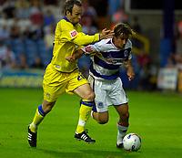 Photo: Daniel Hambury.<br />Queens Park Rangers v Leeds United. Coca Cola Championship. 08/08/2006.<br />QPR's Nick Ward and Leeds' Shaun Derry battle.