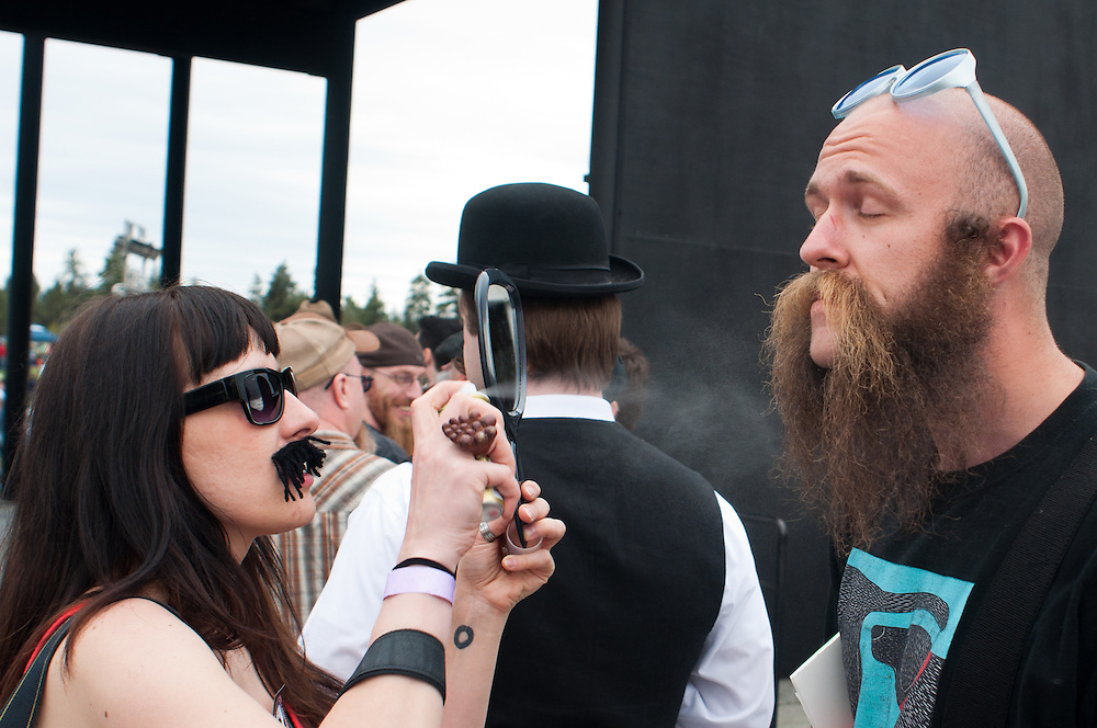 Karolina Gziazda sprays hairspray on Chris Olsen of Nederland, Colorado in Bend, Oregon on Saturday, June 5, 2010 at the Beard Team USA National Beard and Mustache Championships.