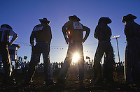 Bull riders line up in the arena as they are introduced during the Dilkon Buckaroo Days Rodeo in Arizona. Each competitor randomly draws the name of the bull that they will ride. Perhaps because it is so risky, bull riding is a favorite with audiences.  The rider must hold on for eight seconds, with added points for steering the bull on a straight course and maintaining proper posture.