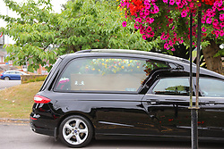© Licensed to London News Pictures. 30/07/2018. Salisbury, UK. The hearse arrives at Salisbury Crematorium before the funeral of Dawn Sturgess, who died on 8 July 2018 after exposure to the nerve agent Novichok. Special safety measures have been put in place to protect mourners attending the ceremony. Photo credit: Rob Pinney/LNP