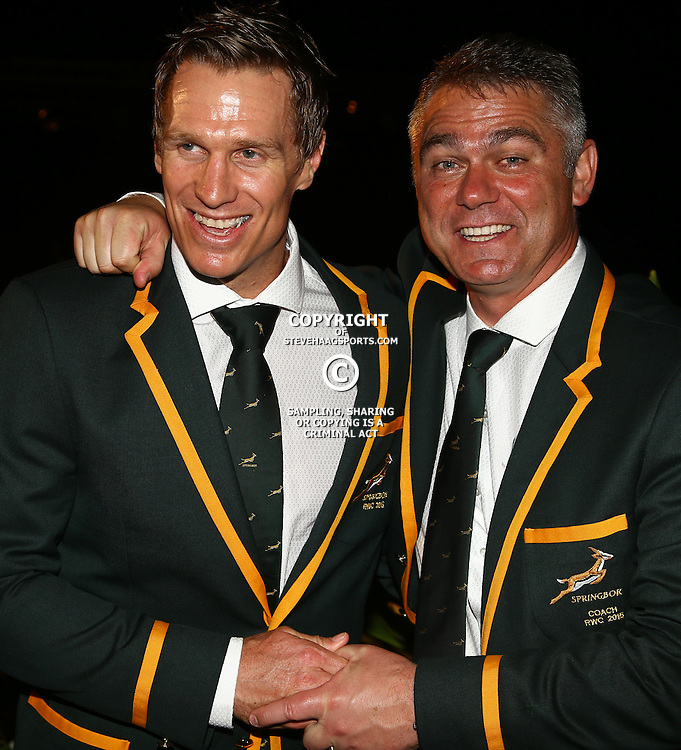 DURBAN, SOUTH AFRICA - AUGUST 28: Jean de Villiers (C) with Heyneke Meyer (Head Coach) of South Africa during the South African national rugby team World Cup Squad announcement at Beverly Hills Hotel on August 28, 2015 in Durban, South Africa. (Photo by Steve Haag/Gallo Images)