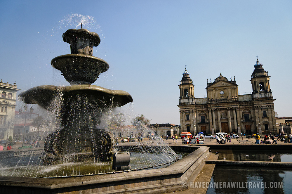 Fountain in Parque Central (officially the Plaza de la Constitucion) in the center of Guatemala City, Guatemala. In the background to the left is the Catedral Metropolitana.