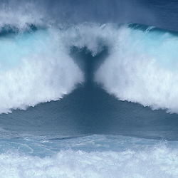 Photo illustration of blue ocean wave in heart shape