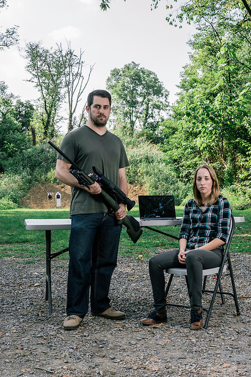 Security researchers Michael Auger, left, and wife Runa Sandvik, right, have figured out how to hack into a Tracking Point TP750 rifle to control the trajectory of the bullets fired.