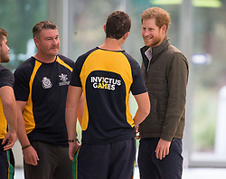 Prince Harry speaks to members of the Australian Invictus Games swimming squad during a visit to the Aquatic Centre at the Olympic Park Sports Centre in Sydney, Australia, which will be one of the venues for the Invictus Games Sydney 2018.