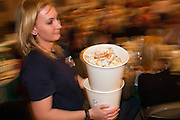 Spring Valley Volunteer Fire Department member Christina Bruce carries buckets of crab to guests during the Milpitas Chamber of Commerce 21st Annual Auction & Crab Feed at Napredak Hall in San Jose, California, on March 7, 2014. (Stan Olszewski/SOSKIphoto)