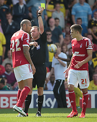 Nottingham Forest's Kelvin Wilson receives a yellow card from  referee Oliver Langford   - Photo mandatory by-line: Nigel Pitts-Drake/JMP - Tel: Mobile: 07966 386802 25/08/2013 - SPORT - FOOTBALL -Vicarage Road Stadium - Watford -  Watford v Nottingham Forest - Sky Bet Championship
