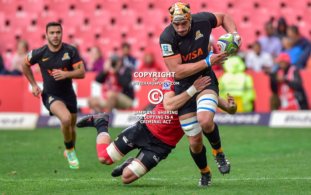 Johannesburg, SOUTH AFRICA, 21, MAY 2016 - during the Super Rugby match between Emirates Lions vs Jaguares ,Emirates Airlines Park,Johannesburg. <br /> Warren Whiteley of the Emirates Lions tackling Tomás Lavanini of the Jaguares <br /> <br /> South Africa. (Photographer Christiaan Kotze ) -- (Steve Haag Sports) <br /> <br /> Images for social media must have consent from Steve Haag