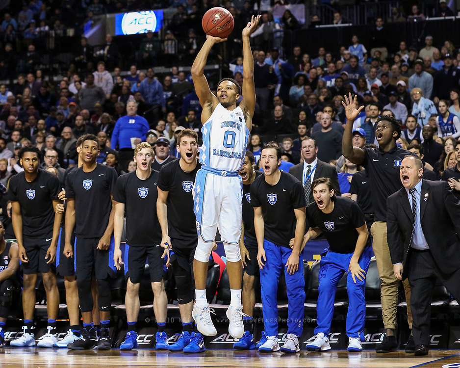 North Carolina guard Nate Britt (0) shoots a three in front of the Duke bench during the semifinals of the 2017 New York Life ACC Tournament at the Barclays Center in Brooklyn, N.Y., Friday, March 10, 2017. (Photo by David Welker, theACC.com)