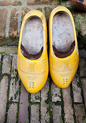 Traditional old painted wooden clogs in Delft, The Netherlands