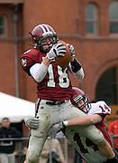 Steve Houser (18) from Wesleyan University ties the game against Bates College in Middletown, CT. on Oct. 17, 2009. Wesleyan won 28-20.