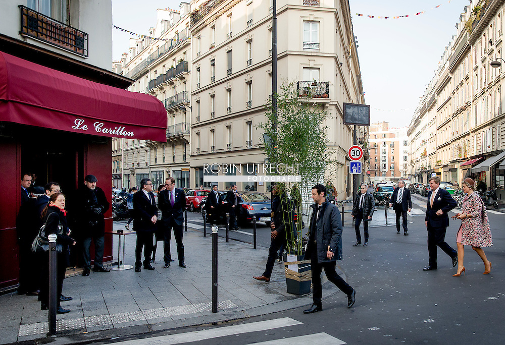 PARIS - Dutch king Willem-Alexander and queen Maxima arrive at the cafe Le Carillon in Paris, France, March 11, 2016. The Dutch royals spoke with the owner, a member of the staff, residents and rescueworkers who were present during the November 13, 2015 attacks on Paris. copyrigjt robin utrecht