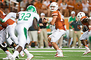 AUSTIN, TX - AUGUST 30:  David Ash #14 of the Texas Longhorns throws a pass against the North Texas Mean Green on August 30, 2014 at Darrell K Royal-Texas Memorial Stadium in Austin, Texas.  (Photo by Cooper Neill/Getty Images) *** Local Caption *** David Ash