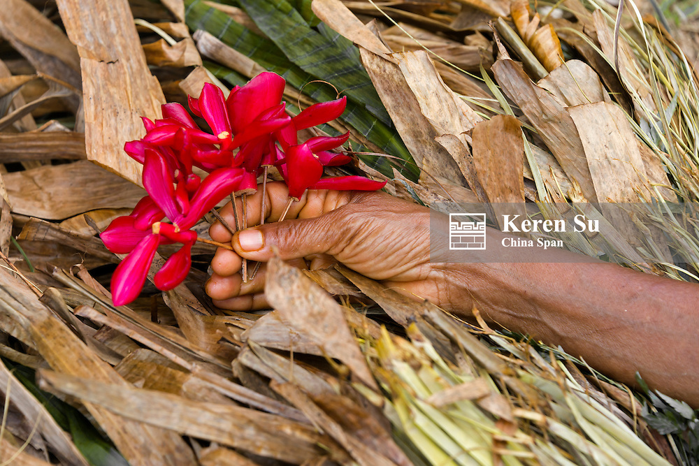 Holding flowers, Yap Island, Federated States of Micronesia