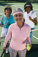 Three women on tennis court, portrait