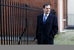 © licensed to London News Pictures. London, UK 08/01/2014. George Osborne, the Chancellor of the Exchequer leaving Downing Street on Wednesday, 08 January 2014. Photo credit: Tolga Akmen/LNP